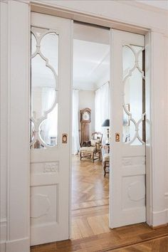 Pocket doors. I also love the look of pocket doors with beautiful molding + glass. It can add something super special to your space. I love this about older homes, they sometimes will just be already built in. If your home has pocket doors, but the look is a little boring you can add a dash of color for a fun surprise.   straton interiors