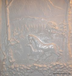 Plaster bas-relief using molds from Elite Artistry. Molds help make sculpting bas-relief wall murals.