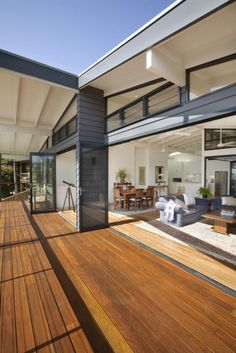 exactly a dark exterior meets a beautiful white interior! I would just sain the exterior timber deck a different colour or let it age a pale grey naturally