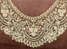"Duchesse bobbin lace ""This Belgian lace style developed in the 1850's. Parts were constructed separately with filmy linen stitch or half stitch, and then assembled."""
