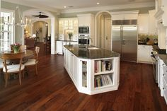 Cape Cod Traditional Kitchen traditional kitchen with an island on a diagonal to maintain the perfect triangle design.