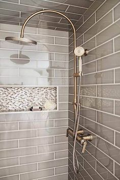 GRAY SHOWER TILE-Gray walk in shower boasts ceiling and walls clad in gray tiles fitted with a white and gray mosaic tiled shower niche as well as a vintage style exposed plumbing shower kit. Tile Shower Niche, Mosaic Shower Tile, Gray Shower Tile, Gray Tiles, Bathroom Gray, Bathroom Closet, Shower Walls, Shower Ceiling Tile, Modern Bathroom