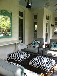 New porch colors. Navy fabrics with my teal bench and newly dark browned stained concrete floor. Light gray/brown bottom panels