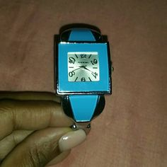 Silver tone watch Pretty silver tone watch with a soft blue, needs battery but other than that like new Accessories Watches