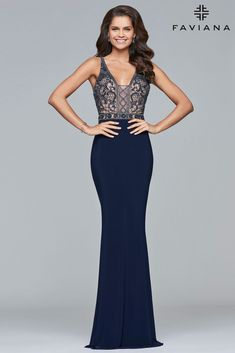Blow the crowd away in one of our sexy evening dresses. FAVIANA S10092 is a navy long jersey v-neck dress with beaded bodice