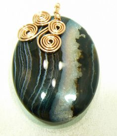 Gosh I love the colors in this, I may end up keeping it Black Banded Agate Pendant with Hand Made Copper Bail