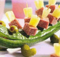 A cucumber, pickles, olives, etc, to make a funny crocodile. Love it!