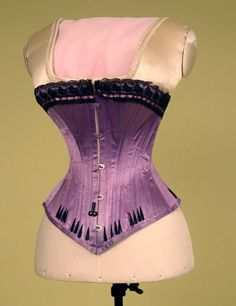 Victorian violet corset, stunning. Currently working on a Sparklewren midbust sample corset in a deep violet shade, with inky black details, lace and feathers.