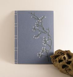 Embroidered Notebook / Blooming Branch / Blue, via Etsy.