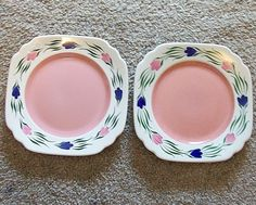 2 Syracuse China light pink floral restaurant plates, one from 1946 and the other from 1952