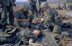 In this April 2, 1967 file photo shot by Associated Press photographer Horst Faas, wounded U.S. soldiers are treated on a battle field in Vietnam.