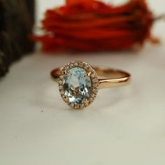 Handmade Natural Aquamarine Engagement Ring in 14K Rose Gold 9x7mm Oval Aquamarine Wedding Ring Halo Diamond Ring-Bridal Set Available by MidPointDesign on Etsy https://www.etsy.com/listing/272422248/handmade-natural-aquamarine-engagement
