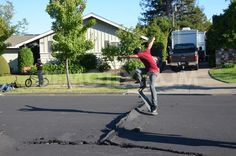 teens-use-buckled-road-caused-by-napa-earthquake-as-skate-park