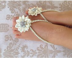 A personal favorite from my Etsy shop https://www.etsy.com/listing/218445635/baby-barefoot-sandals-christening-flower