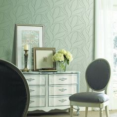 Great example of big, medium and small patterns. Large graphic wallpaper, a medium scale art piece on the dresser and a narrow stripe on the chairs. Yet with all these patterns, the tone of the room exudes relaxation. Decor, Bed Decor, Blue Home Decor, Dresser Decor, Elegant Homes, Blue Decor, Bedroom Decor, Trending Decor, Home Decor