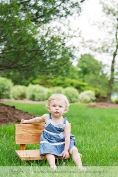 little girl sitting on bench photography outdoor
