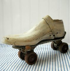 Vintage wooden shoe form.  I have several of these....bought them several years ago at a flea market....paid $1.00 for each.   Now all I need is a roller skate......Love this look.