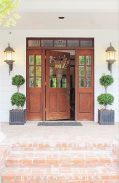 Front Door with source to buy these gorgeous FAUX topiaries | source for fake topiary | www.11gables.blogspot.com