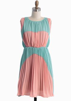"""Lovely Rhapsody Colorblocked Dress 46.99 at shopruche.com. UK sizes. Elegant sunburst pleats lend graceful movement to this playful colorblocked dress in mint and peach. Polished with a back button keyhole closure and an elasticized waist for a comfortable and flattering fit. Fully lined.100% Polyester, Imported, 33.5"""" length from top of shoulders, 34"""" bust, All measurements are taken from a size 10"""