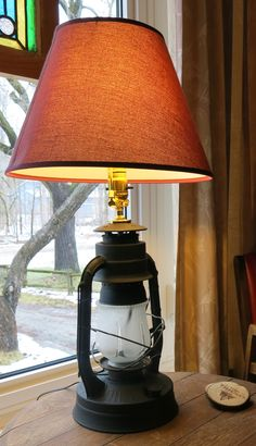 I upcycled an old railway signal oil lamp into a cool lamp for the front window.