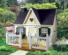 9 DIY Kids' Playhouses We Love: Victorian Playhouse with Deck by HomePlace