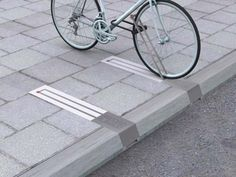 Genius Products 26 These beautiful bike racks don't take up space on the sidewalk when they're not in use