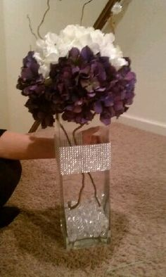 I would change the flowers but I like this DIY Center Piece