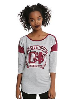 """If the Sorting Hat places you in the Gryffindor House, it's because you are brave and chivalrous!<br><br>This heather grey athletic style raglan from <i>Harry Potter</i> features a Gryffindor inspired design with maroon logo graphic on front, maroon details and 3/4 length sleeves.<br><ul><li style=""""list-style-position: inside !important; list-style-type: disc !important"""">50% cotton; 50% polyester</li><li styl..."""