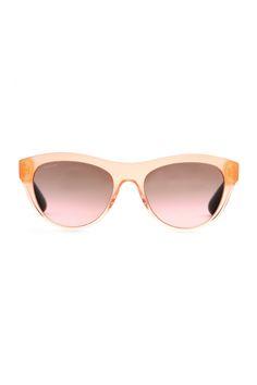 ba71a9e6638 Rock a retro silhouette in a modern citrus color. Miu Miu Cat Eye Sunglasses .