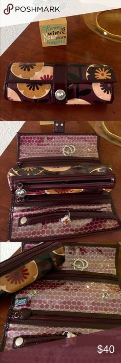 Brighton traveling jewelry case Beautiful traveling jewelry case with removable section.  It has three compartments and one ring holder.  Used maybe twice. Brighton Bags Travel Bags