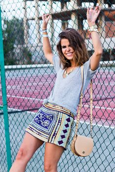 cute satchel and the combination of a cute, simple, and comfortable grey v-neck with a fun printed skirt