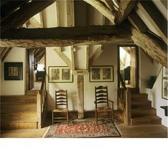 Kelmscott Manor  The servants' garrets at Kelmscott Manor: the Spartan simplicity of these rooms has been maintained. They now contain furniture designed by Holman Hunt.