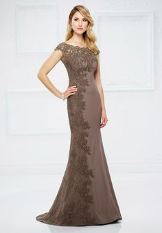 Crepe and lace fit and flare gown with hand-beaded illusion scalloped lace cap sleeves and bateau neckline over sweetheart bodice, beaded lace detail cascades down entire side to hem, illusion lace back, sweep train. Matching shawl included.