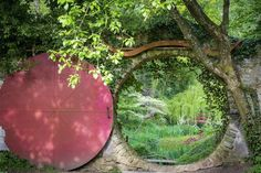 A circular doorway looking onto a green landscaped garden  Annie Green-Armytage discovered a hobbit door, called the Moon Gate, in Bavaria, Germany.