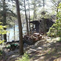 Side porch view of cabin over Green Pond.