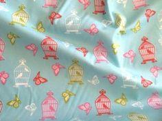Tkanina bawełna MAŁE klatki dla ptaszków na niebieskim turkusie