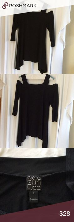 "Cold Shoulder top 3/4 length sleeves.  Black jersey fabric, 70% polyester, 20% rayon, 10% spandex. Bust 18"".   23"" front to hem in the middle, longer sides.  Size small is a 8/10.  EUC. Smoke free pet free home. clara sun woo Tops Tunics"