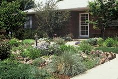 front yard landscape design ideas | shallow front yard is given more depth with added paths and ...