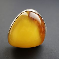 From Poland, a Baltic honey clouded amber ring.