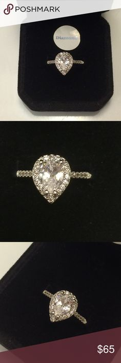 ASHA DIAMOND  RING Size 9. ASHA Diamond . 2.25ct total weight. Pear  Cut Center solitaire Diamond . Cut pear. Clarity pure clear . Quality A-1 . Stamped none . Band white Gold Filled . Diamond encrusted band. Beautiful  comes in black velvet gift box  Wrapped and shipped with care. Ice Jewelry Rings