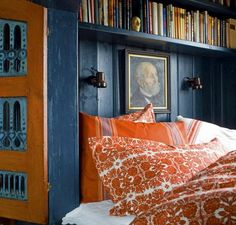 Traditional One-Room Mountain Cabin in Norway This is a cubby bed--orange and blue are complementary colors.