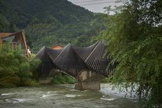 To celebrate bamboo building material, first International Bamboo Architecture took place in Baoxi, China. Bamboo Architecture, Contemporary Architecture, Architecture Details, Contemporary Design, Amazing Architecture, Interesting Buildings, Amazing Buildings, Bamboo Building, Valley Landscape