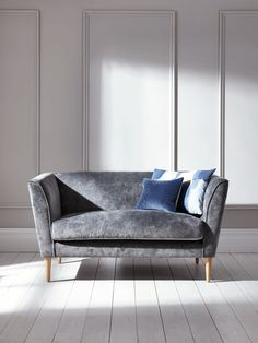 Handmade in the UK with a solid birch and beech hardwood frame, our high quality occasional sofa has a luxurious Italian grey velvet finish and four slender solid oak legs. Simple in shape with a fixed cosy seat cushion, sprung back and cushioned armrests, each piece is padded with high density foam, which has been interwoven by hand with a feather wrap and elasticated webbing. Beautiful in its versatility, our Timsbury Sofa can be styled to suit your home.