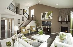 Note how the brown accent wall in this open-concept living room helps to define the space and orient the viewer.