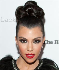 This bun is OFF THE CHAIN.. the spidery lower lashes... not a fan