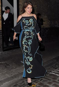 Princess Eugenie's dress that light up the night with its electric blue and turquoise embroidery that jumped off the black background of her glamorous floor sweeping number. Allowing the focus to remain on her eye-catching dress, the young royal kept her accessories simple with a pair of black heels and simple black clutch. She complimented the drama of the dress with a bold red lipstick