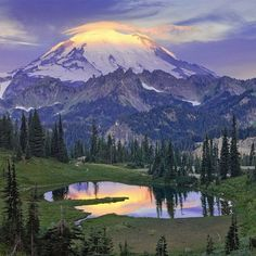 The first rays of sun hit the top of Mount Rainier and are reflected on the mirror-like surface of Tipsoo Lake. It's an incredible sight and easy to experience. #MountRainier #NationalPark in #Washington Photo by Bob Kim (www.sharetheexperience.org).
