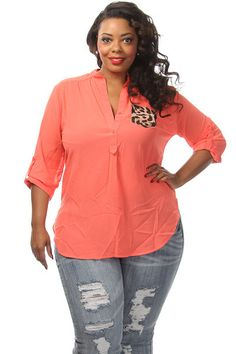 This cute lightweight plus size top features a solid body leopard print side pocket and adjustable sleeves Soft, non stretch material Loose fit 100% Polyester Model wearing 3X Imported