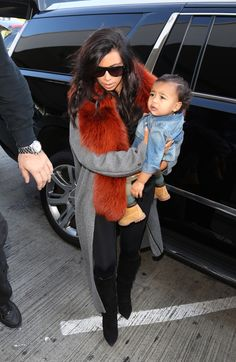 Kim & North arriving at LAX airport - September 22, 2014