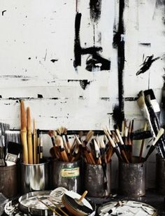 Used metal cans for storing art supplies